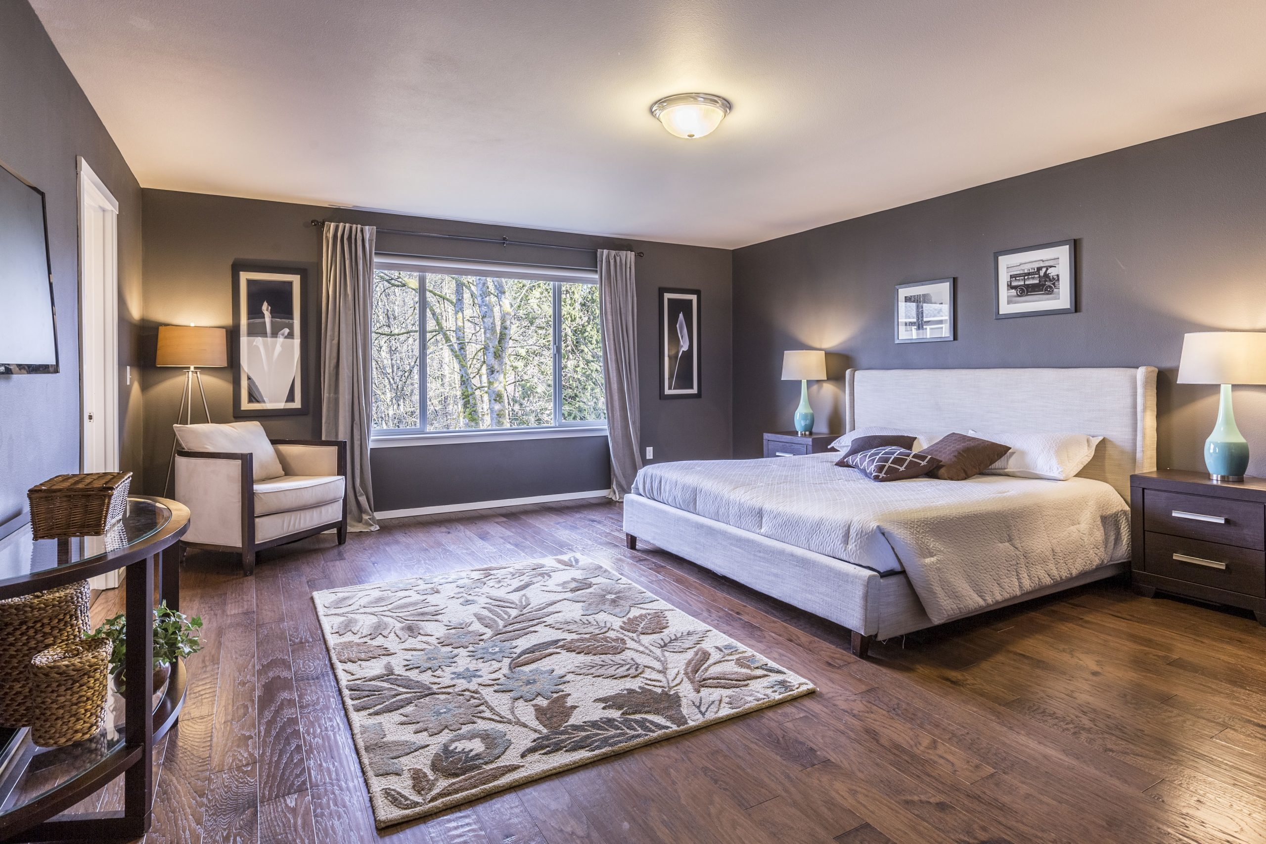 Master-bedroom-with-king-size-bed-and-hardwood-floor-scaled